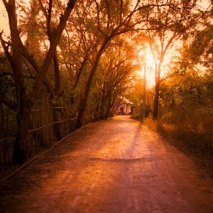 Sunset at a small road crossing Gili Meno.