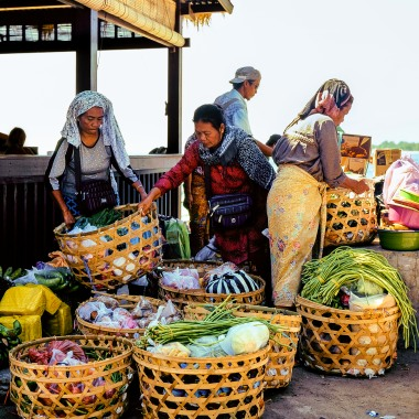 Business owners sorting produce.