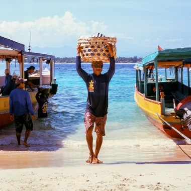 A porter carrying goods on his head.