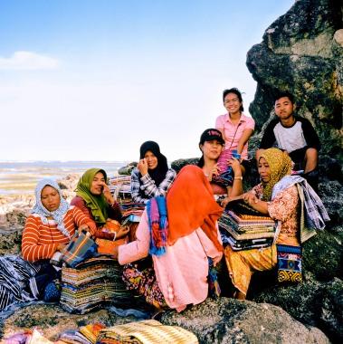 Fabric vendors displaying their goods at Kuta beach, Lombok.