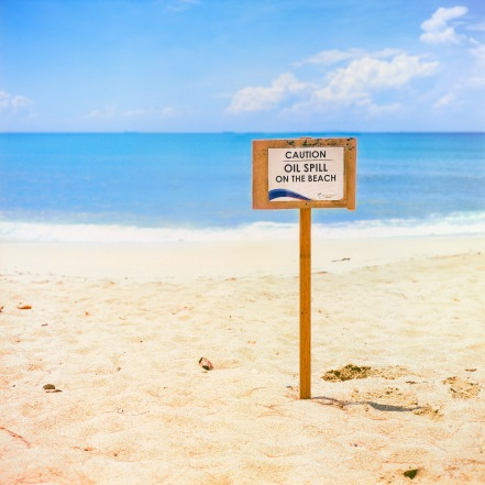 A sign warning for oil spill on Desaru beach, Malaysia.