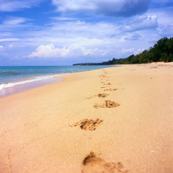 Footprints on the Desaru beach, Malaysia.